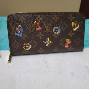 Louis Vuitton love lock zippy wallet
